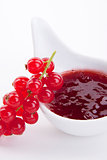 tasty fresh red currant jam isolated on white