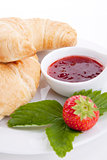deliscios fresh croissant with strawberry jam isolated