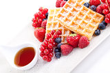 sweet fresh tasty waffles with mixed fruits isolated