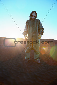 Man in protective suit and rays of sun