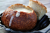 Mussel soup in a pot of bread
