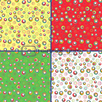 Four seamless vector patterns with colorful circles