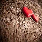 Love of red hearts on wooden background