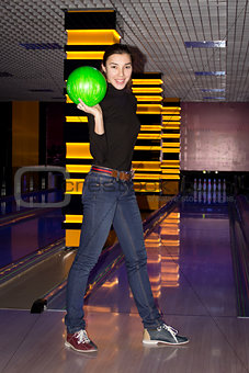 Smiling girl with bowling ball