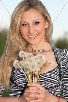 attractive blonde with  dandelions