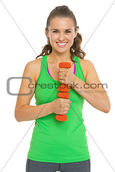 Portrait of smiling fitness young woman with dumbbells