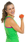 Portrait of fitness young woman with dumbbells