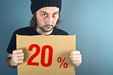Man holding cardboard paper with sales discount price