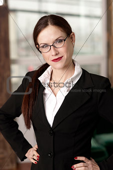 Business Woman Hands on Hips in Work Office