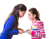 Teen girls fighting for digital tablet