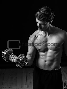 Young man doing bicep curls