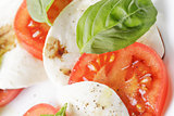 caprese salad made on cutting board