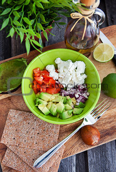 Avocado, tomato, onion and feta cheese salad