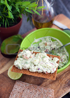 Avocado and feta cheese appetizer on crispbread