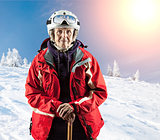 Old woman standing in winter ski goggles on snow holiday in mountains. With clipping path.