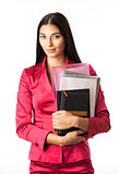 Portrait of a young beautiful girl holding files and standing against white background