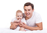 Young Caucasian father with baby son over white