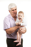 Portrait of a mature grandfather holding grandson over white