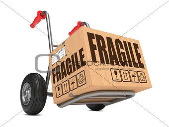 Fragile - Cardboard Box on Hand Truck.