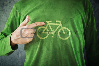 Ride your bike. Man pointing to bicycle insignia printed on his