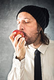 Businessman eating red apple