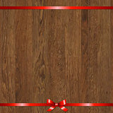 Wood Background With Red Bow