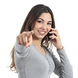 Woman pointing at camera calling on the mobile phone