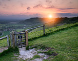 Vibrant sunrise over countryside landscape