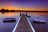 Sunset moorings and boat jetty in a little cove Australia
