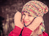Winter Woman Beautiful happy smiling Face wearing knitted hat and scarf with mittens Lifestyle concept and Christmas holiday trendy colors