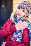 Young Woman Beautiful happy smiling Face Winter time wearing knitted hat and scarf with mittens Lifestyle urban fashion style concept and Christmas holiday