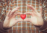 Heart shape love symbol in man hands Valentines Day romantic greeting people relationship concept winter holiday