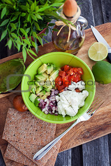Avocado, tomato, onion and feta cheese salad