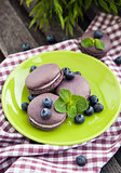 Violet french macarons with blueberry and mint