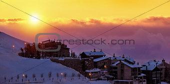 Beautiful sunset in snowy mountainous village
