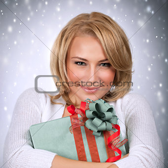 Beautiful female with Christmas gift