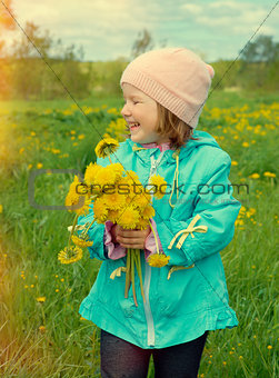 small girl  on meadow