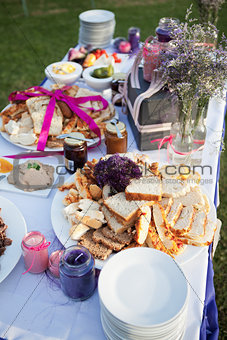 Assortment of bread and condiments on table at a wedding