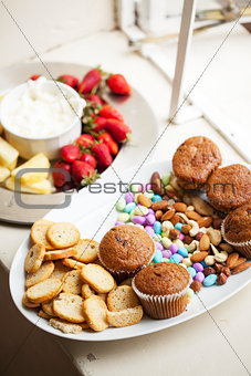 Assortment of snacks served on white platters