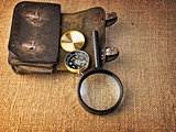 Vintage background with  wallet, compass and magnifier