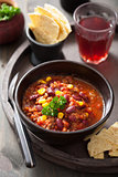 mexican chili con carne in black bowl with tortilla