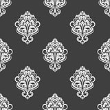 Geometric seamless pattern with floral motifs