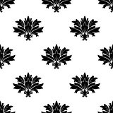 Black silhouette foliate motif in a seamless pattern