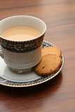 A cup of tea with biscuits