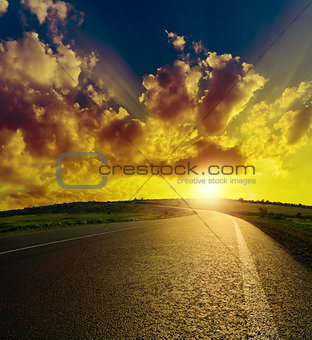 asphalt road to sunset
