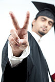 Indian male graduated holding victory sign