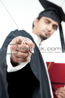 young boy graduated pointing finger in the camera to motivate
