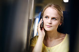 Attractive woman listening to a call on her mobile travelling by train