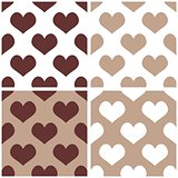 Seamless vector background brown and white set with hearts.