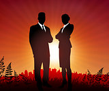 Businessman and Businesswoman on sunset background